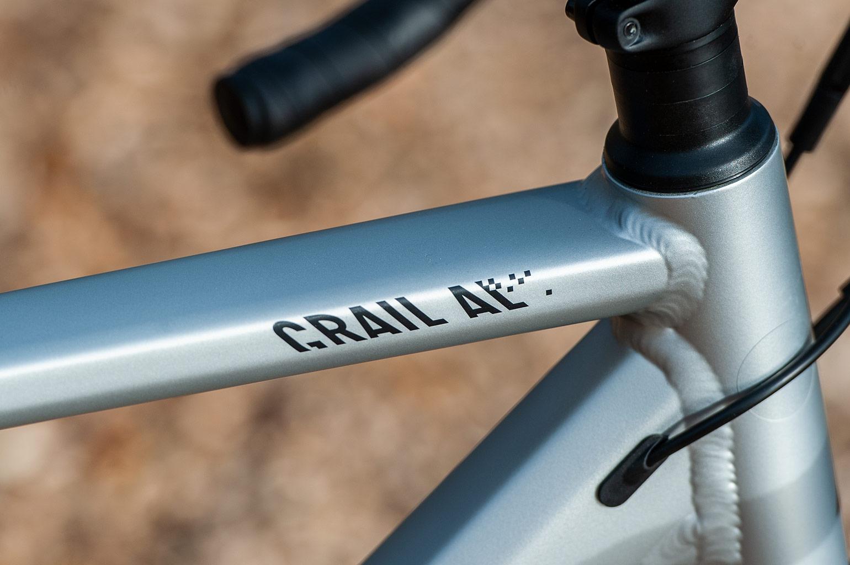 Logo op bovenbuis Canyon Grail AL